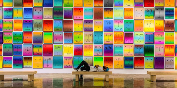 Man laying on a bench in front of an art installation in the NSU Museum in Fort Lauderdale