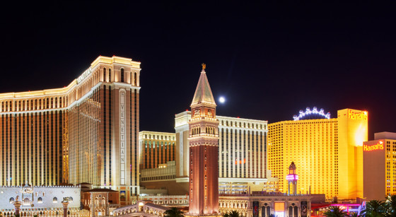 exterior view of The Venetian & Harrah's at night