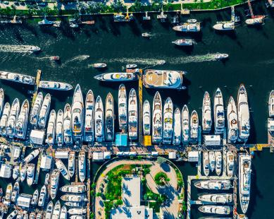 Aerial photo of many yachts moored next to each other
