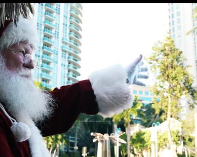 Santa waving from a Cruisin' Tiki on the New River in Fort Lauderdale