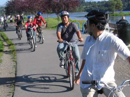 Bikers pedal past Westchester Lagoon.