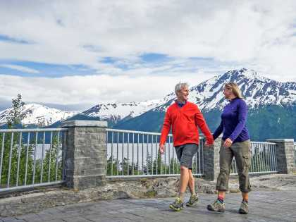 A couple walks at Bird Point along Turnagain Arm.