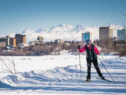Skiers on the Coastal Trail near downtown Anchorage.