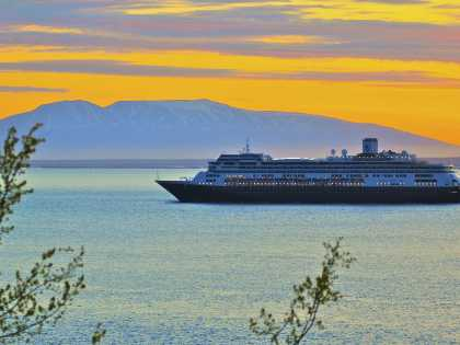 Cruise ship sails down Knik Arm with Mount Susitna nearby