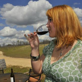 Sampling wine at Pontchartrain Vineyards