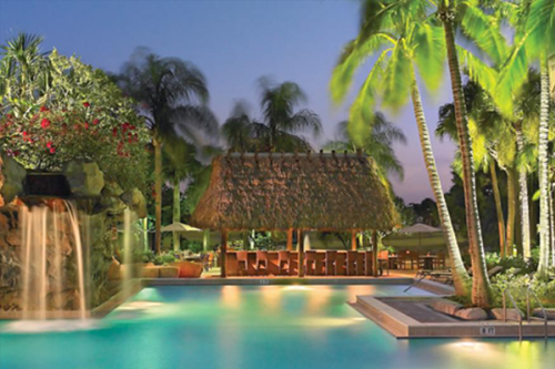 A poolside cabana at the Bonaventure Resort & Spa creates the look of a tropical island oasis.