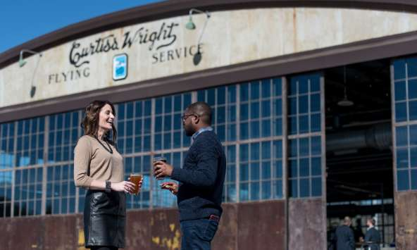 couple_in_front_of_brewery_Hunter_Gatherer_at_Curtis_Wright_Hangar