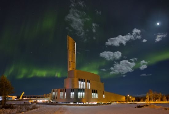 Nordlyskatedralen Cathedral in Alta surrounded by northern lights