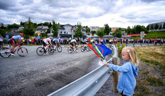 A girl chearing on the peloton at the Arctic Race of Norway