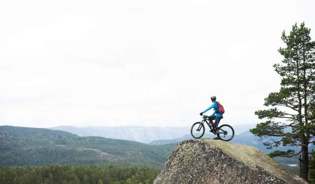 Biker watching a horizon in Nissedal, Telemark