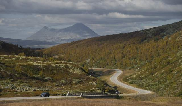 Car driving on a road near the Dovrefjell mountains, Eastern Norway