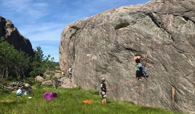 Climbers in action at climbing wall Ny-Hellesund