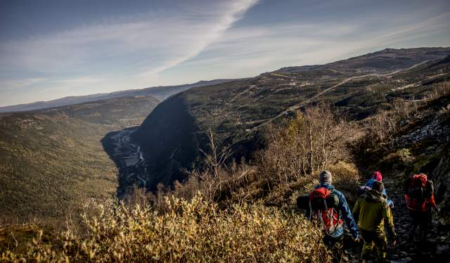 Four people are hiking to Mount Gaustatoppen in Telemark, Norway