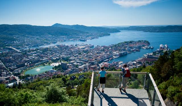 A man and a woman enjoying the view at Mount Fløyen in Bergen