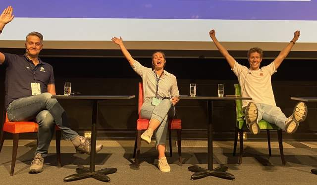 Three people on stage at the Norwegian Swimming Association's coaching and leadership conference in Oslo, Norway