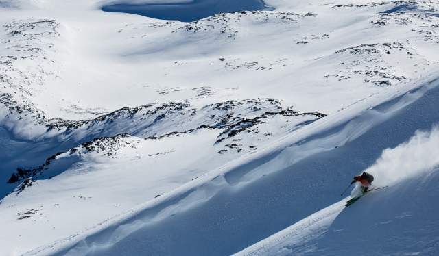 A person does off-piste skiing in an empty snow-clad landscape in Jotunheimen, Eastern Norway