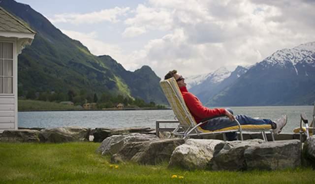 Man relaxing outside Hotel Ullensvang