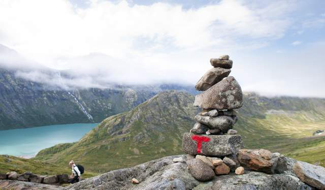 A pile of rocks with a road sign on the Besseggen ridge hiking trail, Jotunheimen, Eastern Norway