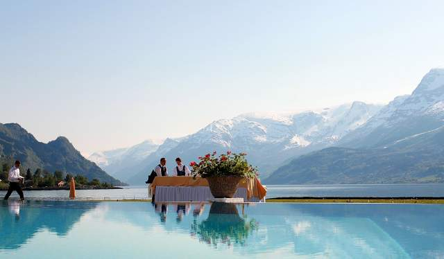 The pool at Hotel Ullensvang in Lofthus, Norway, with the mountains and the Hardangerfjord in the background