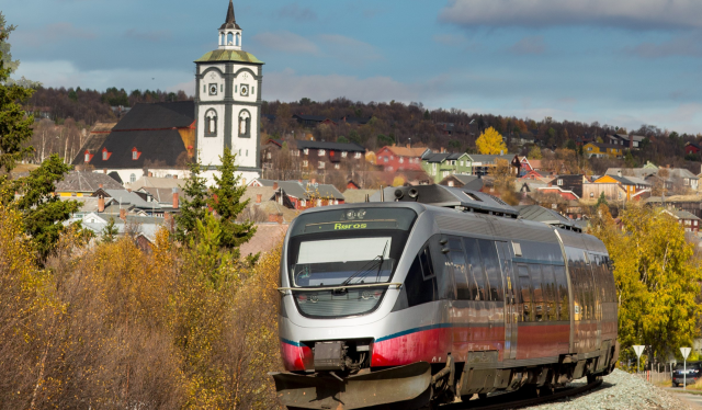 A train on the Rørosbanen with a view on the town of Røros, Trøndelag, Norway