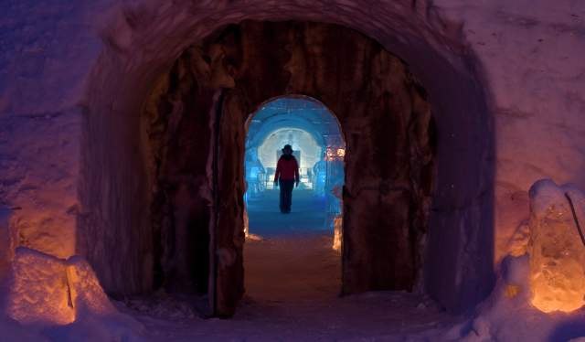 A person in silhouette at the Sorrisniva Igloo Hotel in Finnmark, Northern Norway