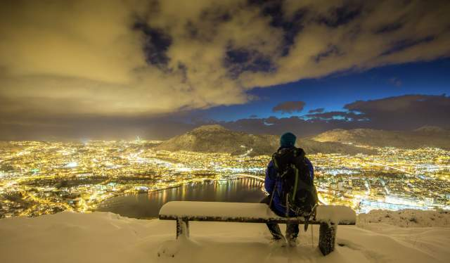 Admiring the view of Bergen from Mount Fløyen in winter, Fjord Norway
