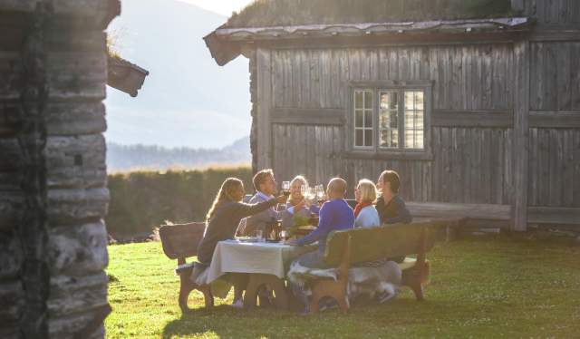 A group of people having dinner outdoors at Brekkeseter in the Rondane mountains, Eastern Norway