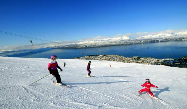 People are skiing at Narvikfjellet ski resort in Narvik, Northern Norway