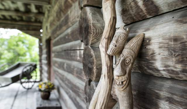 Wooden sticks with troll faces carved into them at Sygard Grytting, Gudbrandsdalen, Eastern Norway