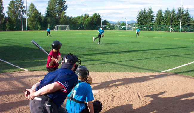 Baseball Field kids playing with umpire watching