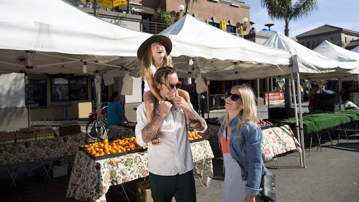As The Sun Sets On A Tuesday Downtown Huntington Beach Attracts Locals And Visitors For Weekly Surf City Nights Street Fair Farmers Market