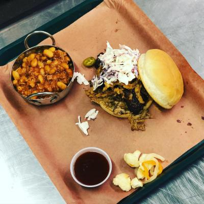 A BBQ sandwich and side on a platter at Stella Blue BBQ
