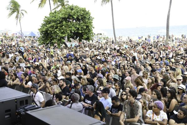 crowd watching a concert on the beach