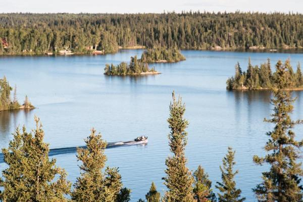 Aerial shot of a fishing boat on a lake in Manitoba