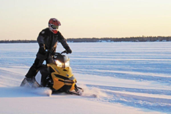 Snowmobiling on the frozen lakes of Manitoba