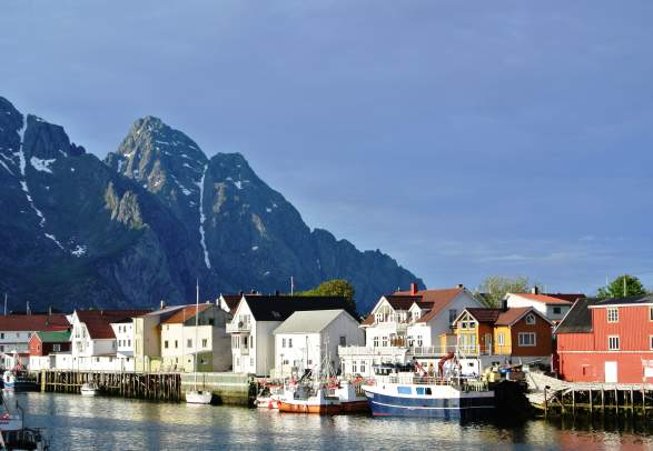 View over the houses near the water and mountains in Henningsvær, Lofoten, Northern Norway