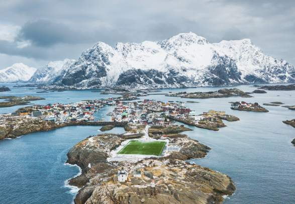A bird's view of the rugged coastline in Henningsvær in Northern Norway