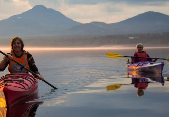 Two women kayaking on Lake Femund