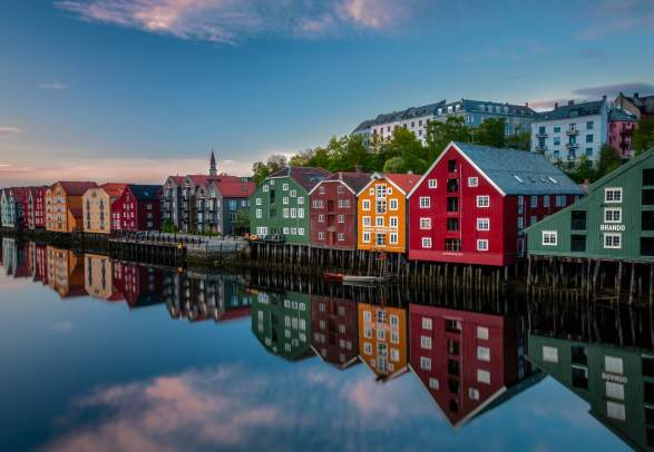 Old historic buildings along the river Nidelva in Trondheim, one of Norway's top places to go