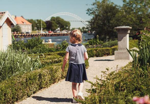 A girl walking in a garden on the island Isegran in Fredrikstad, Eastern Norway