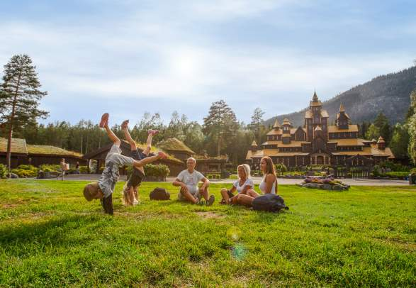 A family is having fun in front of the Fairy Tale Castle in Hunderfossen family park in Lillehammer, Eastern Norway