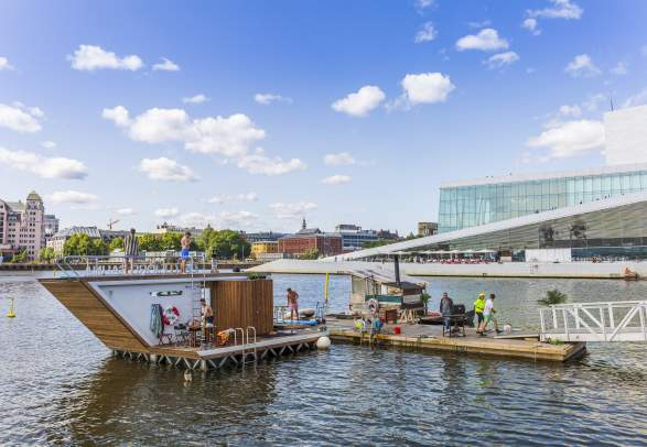 The floating Oslofjord sauna in front of Oslo opera house