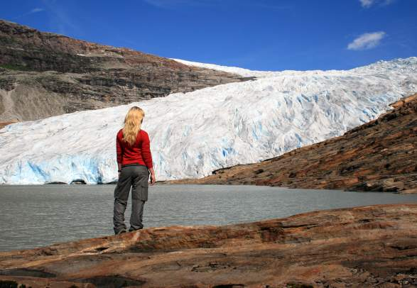 Woman standing in front of Svartisen glacier