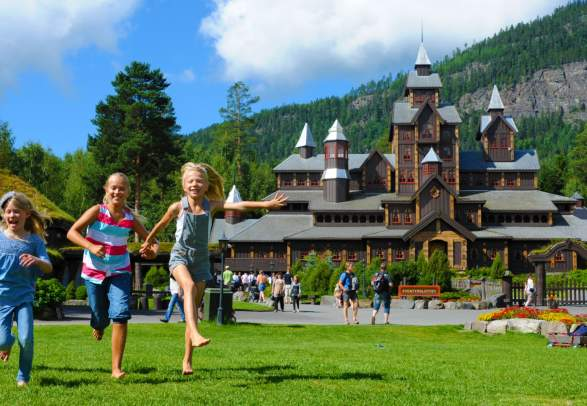 Children playing outside on a sunny summer day at Hunderfossen family park