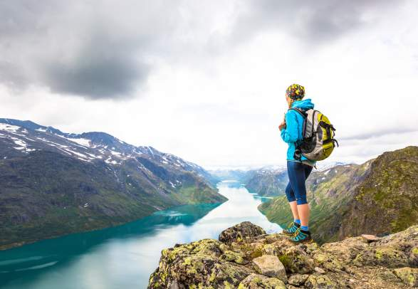 A woman enjoying the view of Lake Gjende from the top of Besseggen in Jotunheimen, Eastern Norway