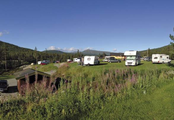 Caravans and motorhomes at Randsverk camping in the Gudbrandsdalen valley, Eastern Norway