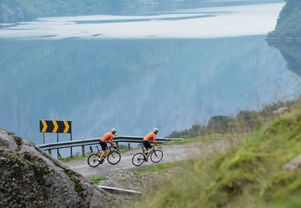 Two people road cycling Skykula in Fjord Norway
