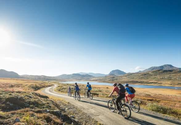 People biking on a gravel road in Ål in Hemsedal, Eastern Norway