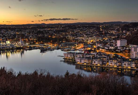 Sandefjord, and the surrounding fjord, seen from a distance at night time
