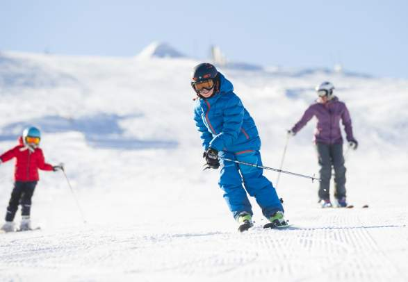 A family alpine skiing in Trysil